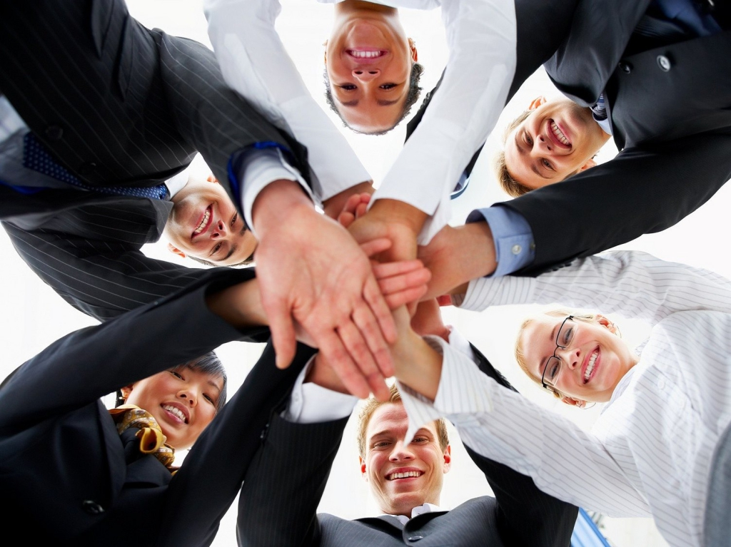 Teamwork and team spirit - Hands piled on top of one another .